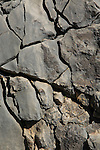 Close up weathered cracks carboniferous rock, near Tarbena, Marina Alta, Alicante province, Spain
