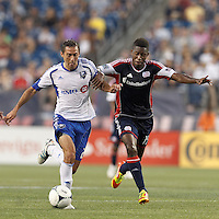 Montreal Impact forward Davy Arnaud (22) dribbles as New England Revolution midfielder Clyde Simms (19) defends. In a Major League Soccer (MLS) match, Montreal Impact defeated the New England Revolution, 1-0, at Gillette Stadium on August 12, 2012.