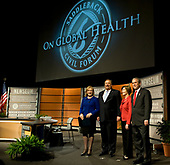 United States President George W. Bush, right, along with first lady Laura Bush, second right, Kay Warren, left and Rick Warren, second left,  participate in Saddleback Civil Forum on Global Health at the Newseum in Washington, D.C., Monday, December 1, 2008.<br /> Credit: Mannie Garcia / Pool via CNP