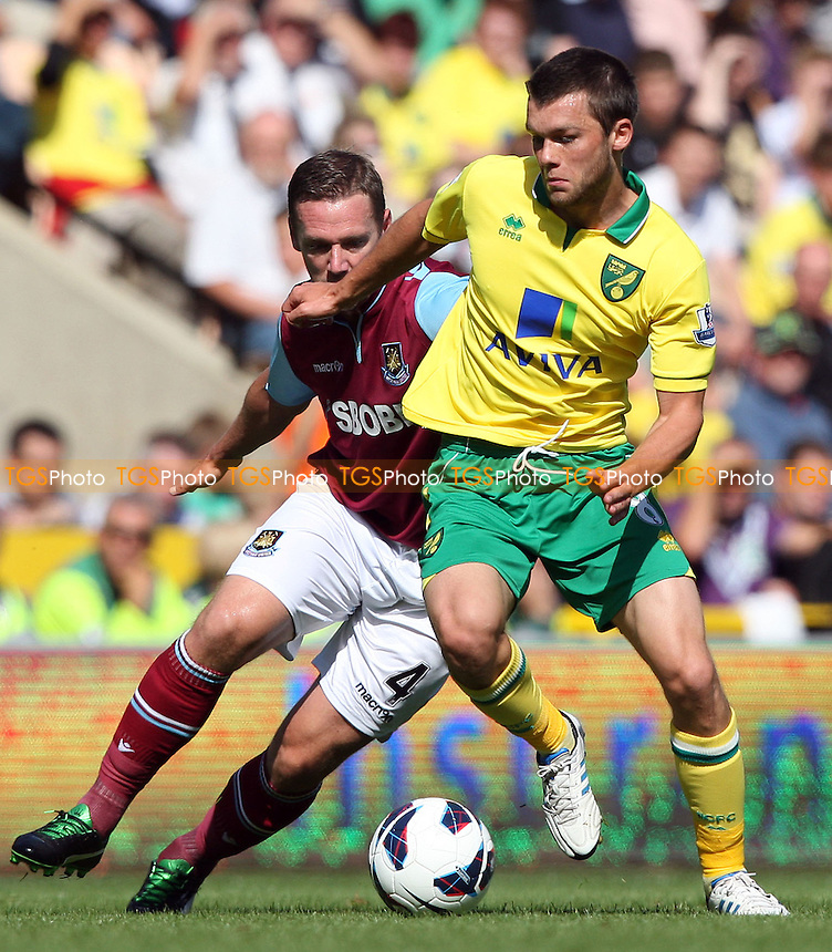Kevin Nolan of West Ham and Jonny Howson of Norwich - Norwich City vs West Ham United, Barclays Premier League at Carrow Road, Norwich - 15/09/12 - MANDATORY CREDIT: Rob Newell/TGSPHOTO - Self billing applies where appropriate - 0845 094 6026 - contact@tgsphoto.co.uk - NO UNPAID USE.