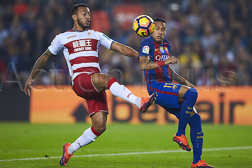 29.10.2016 Barcelona. La Liga football league.  Vezo (Granada CF) duels for the ball against Neymar da Silva Jr (FC Barcelona), during La Liga soccer match between FC Barcelona and Granada CF, at the Camp Nou stadium in Barcelona