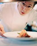 AUSTRIA, Vienna, Chef Heinz Reitbauer holding a dish at Restaurant Steirereck
