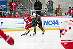 ADRIAN, MI - MARCH 18: Karen Hudson (19) of Plattsburgh State University and Kaylyn Schroka (19) of Adrian College chase a loose puck during the Division III Women's Ice Hockey Championship held at Arrington Ice Arena on March 19, 2017 in Adrian, Michigan. Plattsburgh State defeated Adrian 4-3 in overtime to repeat as national champions for the fourth consecutive year. by Tony Ding/NCAA Photos via Getty Images)