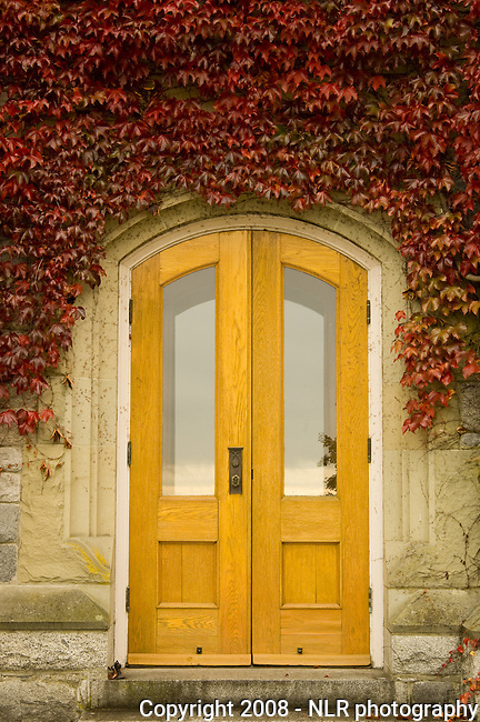 Door to Hatley Castle at Royal Rhodes University in the fall with red ivy covering the walls of the castle