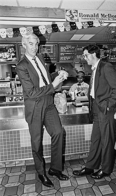 Rep. Tom McMillen, D-Md., with his Big Mac at McDonalds in North Baltimore, Ohio after a hectic day of debates. Rep. McMillen is with campaigning staff assistant, John Rooney on Oct. 20, 1992. (Photo by Maureen Keating/CQ Roll Call)