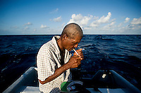 A local fisherman takes a cigarette break during a slow fishing day off the Caribbean coast of Little Corn Island, Nicaragua. Amongst the main catch for local fisherman of shrimp and lobster available fish include: snook, tarpon, jack, mackerel, dorado, red snapper and barracuda...