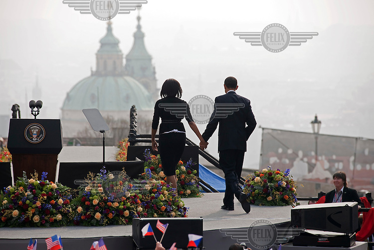 US President Barack Obama with his wife Michelle Obama after his speech, which he gave to a packed Hradcanske Square, in front of Prague Castle.