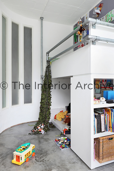 Bunk beds in the children's room combine a play area beneath the sleeping platform