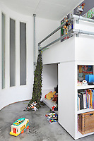 Bunk beds in the children's room combine a play area beneath the sleeping platform