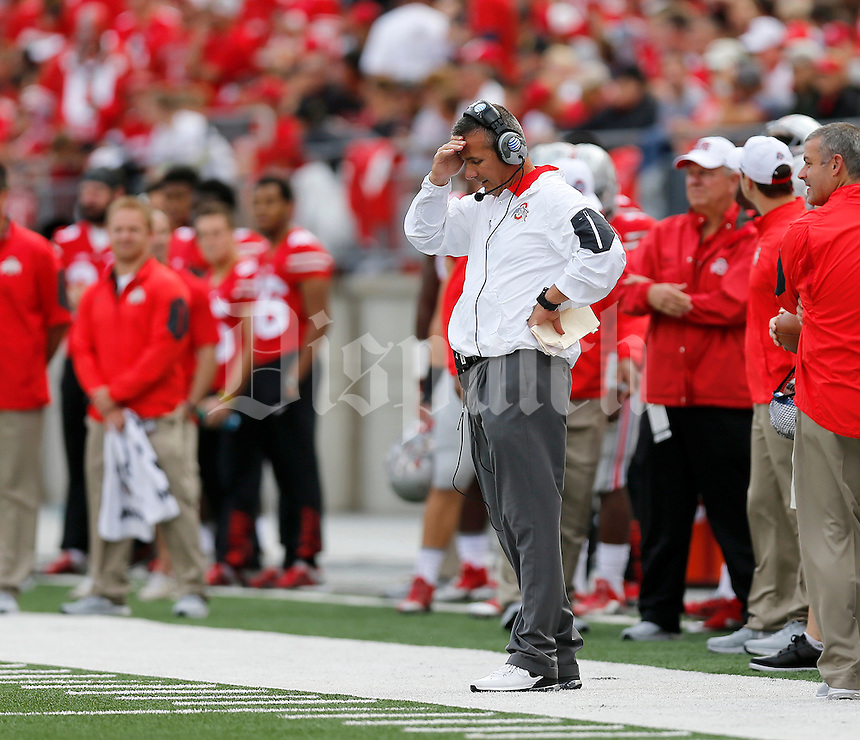 Ohio State Buckeyes head coach Urban Meyer during the first half of the NCAA football game between the Ohio State Buckeyes and the Northern Illinois Huskies at Ohio Stadium on Saturday, September 19, 2015. (Columbus Dispatch photo by Jonathan Quilter)