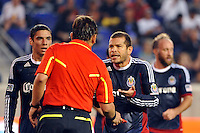 Alejandro Moreno (15) of CD Chivas USA argues with referee Alex Prus. CD Chivas USA defeated the New York Red Bulls 3-2 during a Major League Soccer (MLS) match at Red Bull Arena in Harrison, NJ, on May 15, 2011.