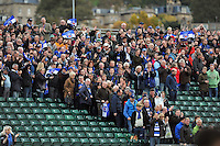 Bath fans in the crowd show their support after the match. European Rugby Champions Cup match, between Bath Rugby and Toulouse on October 25, 2014 at the Recreation Ground in Bath, England. Photo by: Patrick Khachfe / Onside Images