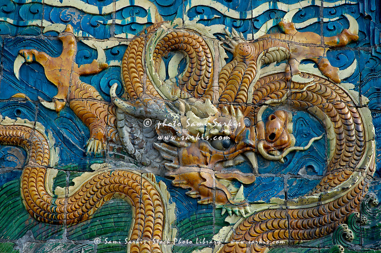 Ornate and decorative dragon on the Nine Dragon Screen in Datong, Shanxi, China.