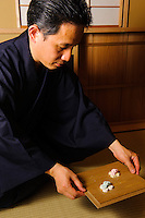 Teamaster Souei Funakoshi serving wasanbon sweets, Torianchado tea school, Tokyo, Japan, April 5, 2012. Wasanbon is served towards the end of the tea ceremony as an accompaniment to thin tea.