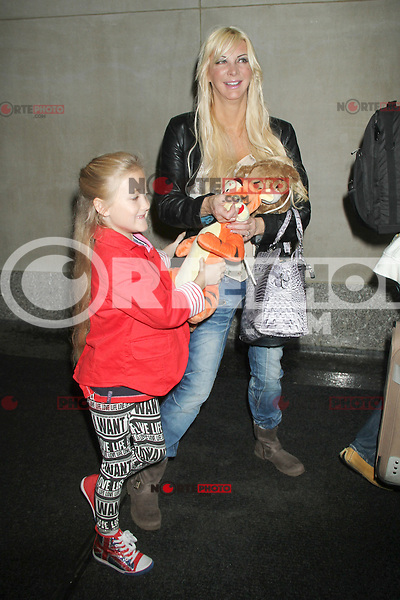 May 09, 2012 Sarah Burge and her daugther Poppy B. Burge of Cambridgeshire England, seen at NBC's Today Show in New York City. Burge discussed the dozens of cosmetic surgeries she's had and earning herself the nickname of Human Barbie. Credit: RW/MediaPunch Inc.