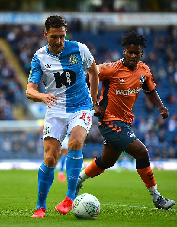 Blackburn Rovers' Stewart Downing vies for possession with Oldham Athletic's Ashley Smith-Brown<br /> <br /> Photographer Richard Martin-Roberts/CameraSport<br /> <br /> The Carabao Cup First Round - Tuesday 13th August 2019 - Blackburn Rovers v Oldham Athletic - Ewood Park - Blackburn<br />  <br /> World Copyright © 2019 CameraSport. All rights reserved. 43 Linden Ave. Countesthorpe. Leicester. England. LE8 5PG - Tel: +44 (0) 116 277 4147 - admin@camerasport.com - www.camerasport.com