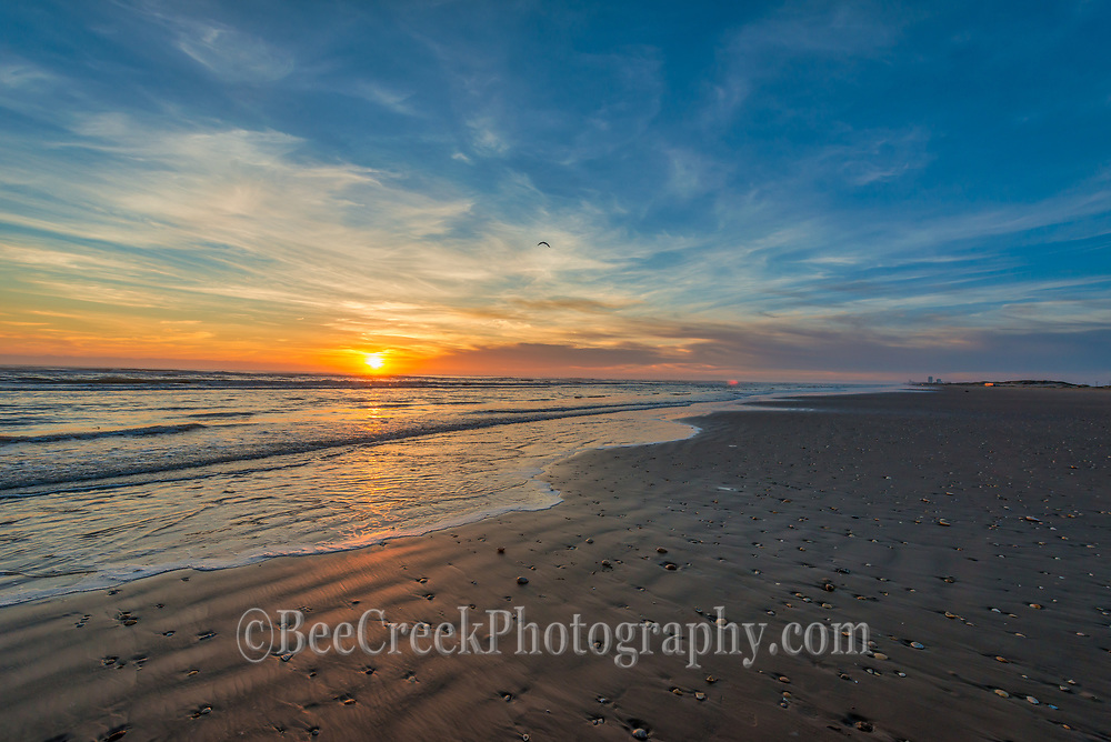 This is an image we took at south padre island as the sun came up over the water.  We had these beautiful whispy clouds and the texture of the sand and surf as it washed up on the sand was wonderful.  The night surf had brought up many sea shells on to the beach to add to this lovely scene.