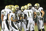 Beverly Hills, CA 09/23/11 - Matt Imwalle (Peninsula #17), Chris Whitehead (Peninsula #36), Joey Augello (Peninsula #58) and Arthur Fischer (Peninsula #67) in action during the Peninsula-Beverly Hills Varsity football game.