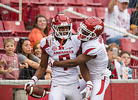 Hawgs Illustrated/BEN GOFF <br /> Trey Knox (left) and De'Vion Warren, Arkansas wide receivers, celebrate after Knox scored a touchdown in the second quarter Saturday, April 6, 2019, during the Arkansas Red-White game at Reynolds Razorback Stadium.