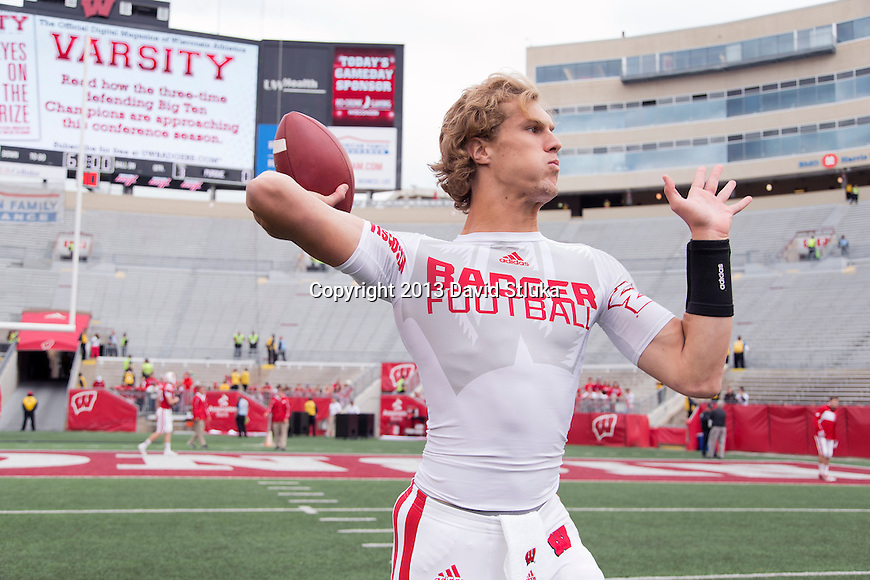 Wisconsin Badgers quarterback Joel Stave (2) throws a pass during warmups prior to an NCAA Big Ten Conference football game against the Purdue Boilermakers on Saturday, September 21, 2013, in Madison, Wis. (Photo by David Stluka)