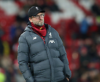 30th October 2019; Anfield, Liverpool, Merseyside, England; English Football League Cup, Carabao Cup, Liverpool versus Arsenal; Liverpool manager Jurgen Klopp watches as the teams warm up prior to the kick off  - Strictly Editorial Use Only. No use with unauthorized audio, video, data, fixture lists, club/league logos or 'live' services. Online in-match use limited to 120 images, no video emulation. No use in betting, games or single club/league/player publications