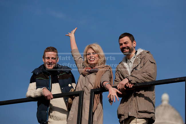 23/02/2012. LONDON, UK. Actress Joanna Lumley waves  as she stands between artists Micheal Elmgreen (L) and Ingar Dragset (R) after unveiling Trafalgar Square's newest addition. Unveiled by actress Joanna Lumey today (23/02/12) in Trafalgar Square, Elmgreen and Dragset's 'Powerless Structures, Fig. 101' replaces the previous sculpture of a ship in a bottle on the famous Fourth Plinth. Photo credit: Matt Cetti-Roberts