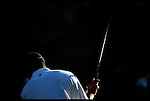 Tiger Woods practice swings in the morning light at the Genuity Open at Doral in Miami, Fl.
