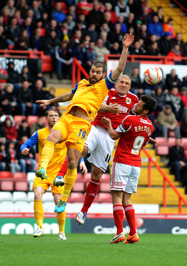 Preston North End's John Welsh battles with Bristol City's Adam El-Abd<br /> <br /> Photo by Ian Cook/CameraSport<br /> <br /> Football - The Football League Sky Bet League One - Bristol City v Preston North End - Saturday 5th April 2014 - Ashton Gate - Bristol<br /> <br /> &copy; CameraSport - 43 Linden Ave. Countesthorpe. Leicester. England. LE8 5PG - Tel: +44 (0) 116 277 4147 - admin@camerasport.com - www.camerasport.com