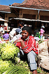 A woman selling salad at the Analakely market in Antananarivo in Madagascar