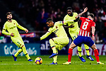 Malcom de Oliveira of FC Barcelona (L) fights for the ball with Saul Niguez of Atletico de Madrid (R) during the La Liga 2018-19 match between Atletico Madrid and FC Barcelona at Wanda Metropolitano on November 24 2018 in Madrid, Spain. Photo by Diego Souto / Power Sport Images