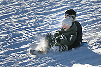 Pictured: Two boys sleigh down the slope at Storey Arms in the Brecon Beacons, Wales, UK. Monday 11 December 2017<br /> Re: Freezing temperatures, snow and ice has affected parts of the UK.