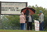LEVITTOWN-TUESDAY, MAY 20, 2008:  People gathered beside School Election signs outside Levittown Memorial High School where Voting is in progress for the School Budget on Tuesday May 20, 2008. NEWSDAY/Jim Peppler.