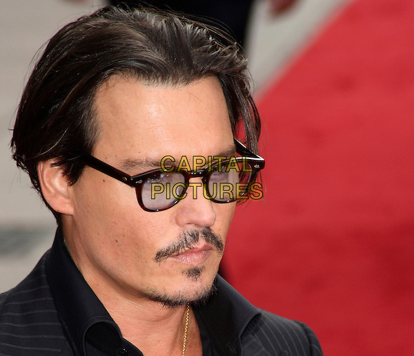 JOHNNY DEPP.European Premiere of 'Public Enemies' at the Empire Cinema, Leicester Square, London, England..June 29th 2009.headshot portrait jacket glasses pinstripe black facial hair goatee .CAP/JIL.©Jill Mayhew/Capital Pictures