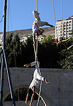 Members of Nablus circus school perform in the West Bank city of Nablus, July 04, 2013. Assirk Assaghir or 'Small Circus' is made up of a small group of motivated trainers, a larger group of enthusiastic students and occasional support from International trainers. It's a non-profit, non-governmental organization whose goal is to provide both participatory education and psychological relief to children and teens that have been affected by conflict in Palestine. Photo by Nedal Eshtayah
