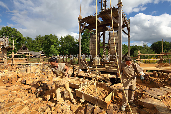 Lifting gear with squirrel cage and double drum, an early form of crane, on the building site in the courtyard at the Chateau de Guedelon, a castle built since 1997 using only medieval materials and processes, photographed in 2017, in Treigny, Yonne, Burgundy, France. The Guedelon project was begun in 1997 by Michel Guyot, owner of the nearby Chateau de Saint-Fargeau, with architect Jacques Moulin. It is an educational and scientific project with the aim of understanding medieval building techniques and the chateau should be completed in the 2020s. Picture by Manuel Cohen