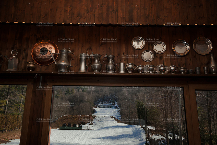 """Switzerland. Canton Ticino. Cureglia is a municipality in the district of Lugano. """"Tiratori del Gaggio"""" society. Shooting range. Targets are distant 300 meters. Snow and trees in winter season. On the wall, several silver plates and cups won on various competitions by shooters from """"Tiratori del Gaggio"""" society. 9.02.2019 © 2019 Didier Ruef"""