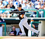 8 March 2011: New York Yankees' infielder Ramiro Pena drops a bunt single during a Spring Training game against the Atlanta Braves at Champion Park in Orlando, Florida. The Yankees edged out the Braves 5-4 in Grapefruit League action. Mandatory Credit: Ed Wolfstein Photo