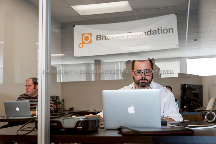 4/1/2014&mdash;Seattle, WA, USA<br /> <br /> Patrick Murck, 38, the Bitcoin Foundation&rsquo;s general counsel at work in the foundations one room office in shared office space in Seattle, WASH. Behind Murck sit  John Stahl (back right), 24, Intrenational Program Manager and Greg Egan (back left), 31, attorney at the Bitcoin Foundation.<br /> <br /> Stuart Isett for The Wall Street Journal<br /> BITFUTURE