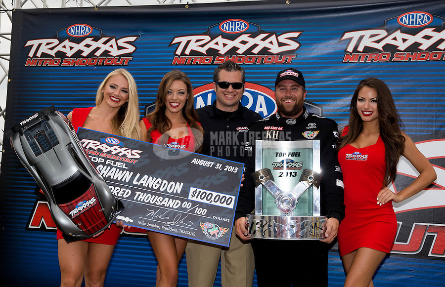 Sept. 1, 2013; Clermont, IN, USA: NHRA top fuel dragster driver Shawn Langdon celebrates after winning the Traxxas Shootout during qualifying for the US Nationals at Lucas Oil Raceway. Mandatory Credit: Mark J. Rebilas-