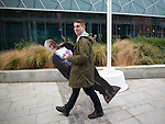 © Joel Goodman - 07973 332324 . 25/09/2016 . Liverpool , UK.  A man carrying a cardboard cutout of Labour Party leader Jeremy Corbyn walking towards the ACC in Liverpool Docks , on the first day of the Labour Party Conference . Photo credit : Joel Goodman