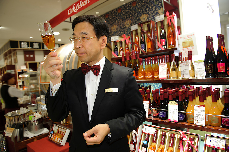 Uchibori vinegar company president, Mitsuyasu Uchibori sampling vinegar at the Oak's Heart vinegar shop, Tokyo, Japan, November 16 2009. Uchibori produces a popular range of drinkable fruit vinegars.