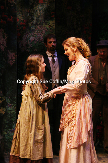 "Isabella Convertino - daughter of Liz Keifer and Sterling Swann in the middle as Philipstown Depot Theatre presents The Secret Garden on November 15, 2009 in Garrison, New York. The musical The Secret Garden is the story of ""Mary Lennox"", a rich spoiled child who finds herself suddenly an orphan when cholera wipes out the entire Indian village where she was living with her parents. She is sent to live in England with her only surviving relative, an uncle who has lived an unhappy life since the death of his wife 10 years ago. ""Archibald's son Colin"", has been ignored by his father who sees Colin only as the cause of his wife's death.This is essentially the story of three lost, unhappy souls who, together, learn how to live again while bringing Colin's mother's garden back to life. (Photo by Sue Coflin/Max Photos)........"