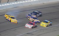 Sept. 28, 2008; Kansas City, KS, USA; Nascar Sprint Cup Series driver Sam Hornish Jr (77) and Michael Waltrip (55) spin during the Camping World RV 400 at Kansas Speedway. Mandatory Credit: Mark J. Rebilas-