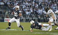 State College, PA - 11/26/2016:  Saquon Barkley (26) carries then ball while being pursued by Michigan State defender Chris Frey. #7 Penn State defeated Michigan State by a score of 45-12 to secure the Big Ten conference East Division championship on Senior Day, Saturday, November 26, 2016, at Beaver Stadium in State College, PA.<br /> <br /> Photos by Joe Rokita / JoeRokita.com