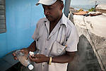 A public servant controlling the water-quality on a rooftop in Santiago De Cuba.