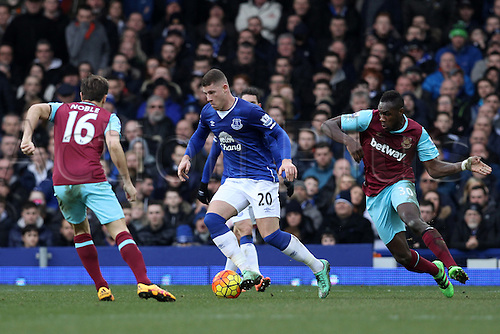 05.03.2016. Goodison Park, Liverpool, England. Barclays Premier League. Everton versus West Ham. Ross Barkley of Everton looks for a way past Mark Noble of West Ham United and Michail Antonio of West Ham United
