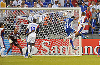 Alvaro Saborio (9) of Costa RIca heads the ball against Edder Deglado (23) of Honduras. Honduras defeated Costa Rica 1-0 at the quaterfinal game of the Concacaf Gold Cup, M&T Stadium, Sunday July 21 , 2013.