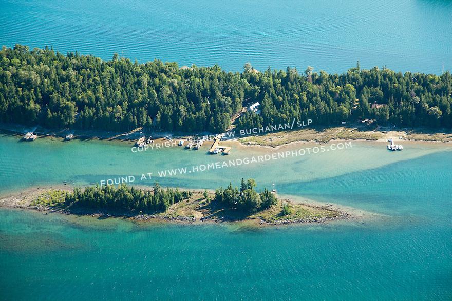 homes and boathouses on Coryell Island shoreline, Les Cheneaux area of Lake Huron near Cedarville, MI