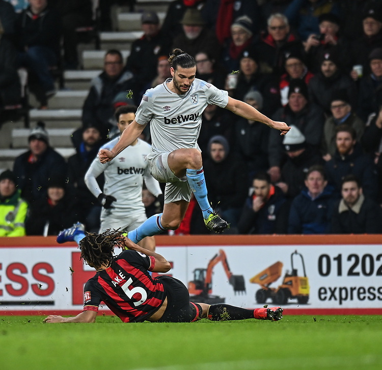 West Ham United's Andy Carroll (right) clears Bournemouth's Nathan Ake (left) <br /> <br /> Photographer David Horton/CameraSport<br /> <br /> The Premier League - Bournemouth v West Ham United - Saturday 19 January 2019 - Vitality Stadium - Bournemouth<br /> <br /> World Copyright &copy; 2019 CameraSport. All rights reserved. 43 Linden Ave. Countesthorpe. Leicester. England. LE8 5PG - Tel: +44 (0) 116 277 4147 - admin@camerasport.com - www.camerasport.com