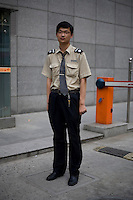 Wangbaoning, a building security guard, age 20, poses for a portrait in Nanjing. Response to 'What does China mean to you?': 'It stands for a unified China at this stage realizing hopes to be the master of its own affairs into the future.'  Response to 'What is your role in China's future?': 'I haven't really thought about it at this point, we'll see, depends on motivation.'